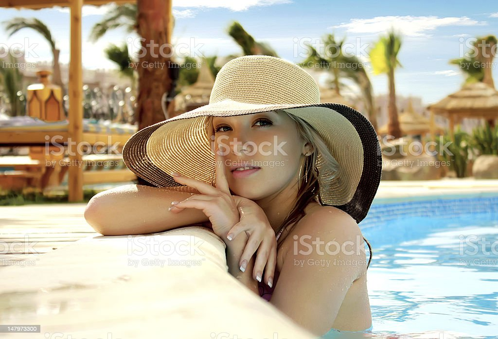 A pretty female wearing a large hat royalty-free stock photo
