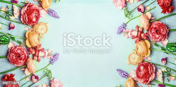 istock Pretty floral banner with various colorful garden flowers on blue turquoise shabby chic background 890771874
