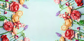 Pretty floral banner with various colorful garden flowers on blue turquoise shabby chic background
