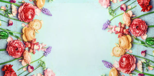 Pretty floral banner with various colorful garden flowers on blue turquoise shabby chic background stock photo
