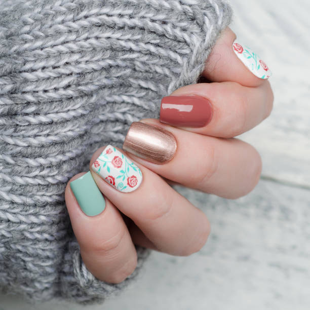 Pretty floral manicure in blue mint and red marsala color with gold picture id1195742772?b=1&k=6&m=1195742772&s=612x612&w=0&h=d bxvphacecomzeoweykktha44hngawumahieb3wou0=