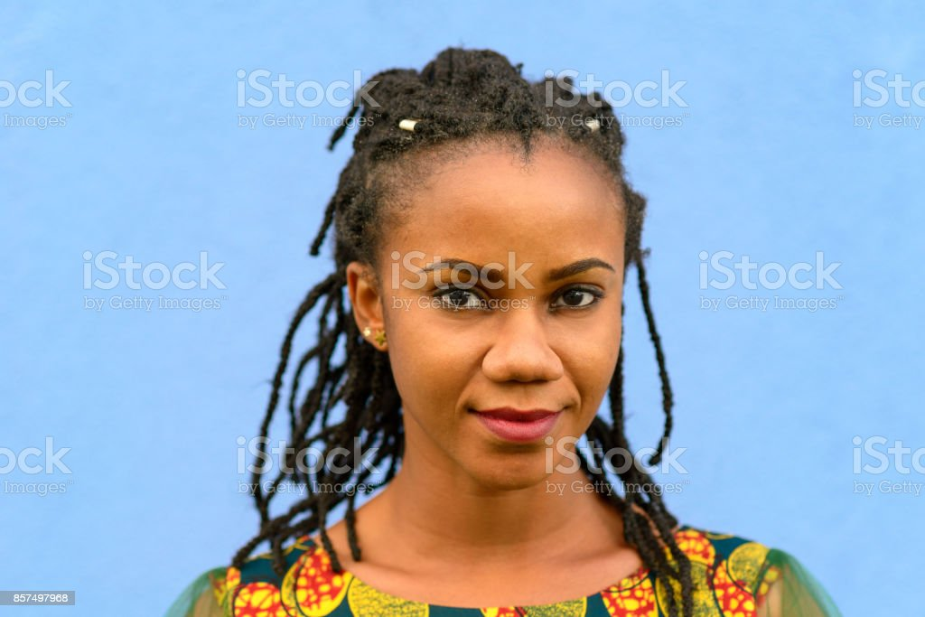 Pretty friendly young African American woman stock photo
