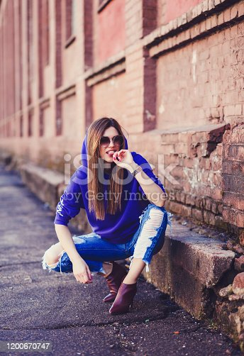624206636 istock photo pretty funny smiling girl in blue clothes 1200670747
