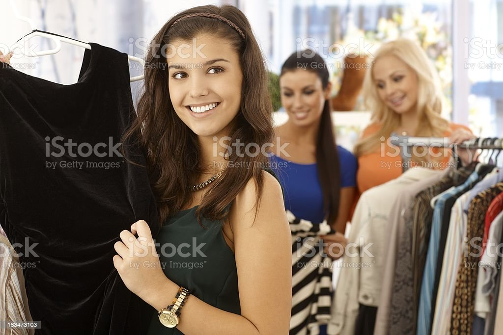 Pretty girl at clothes store royalty-free stock photo