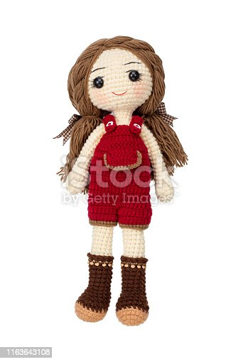 Pretty girl doll crochet by hand make isolated on white background.