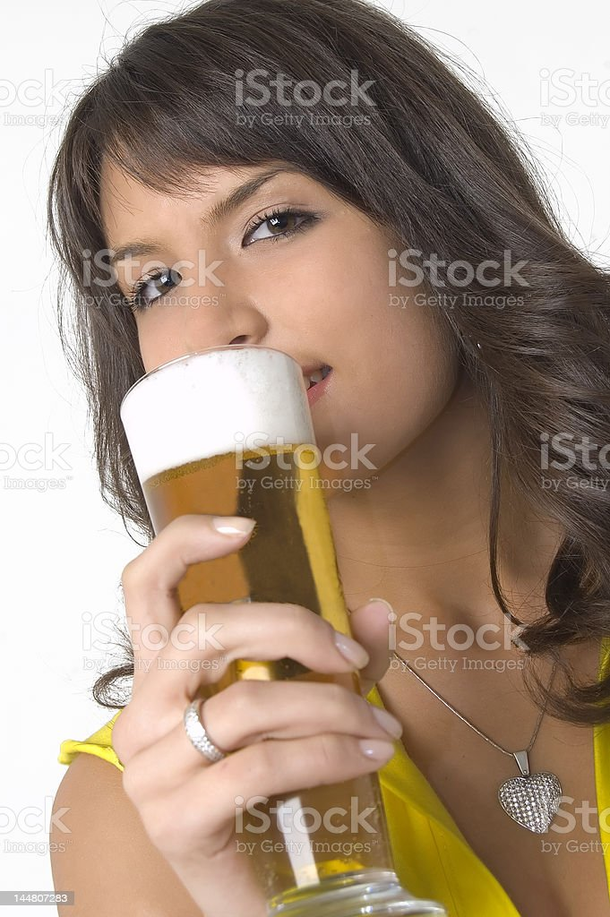 Pretty girl drinking beer from the glass royalty-free stock photo