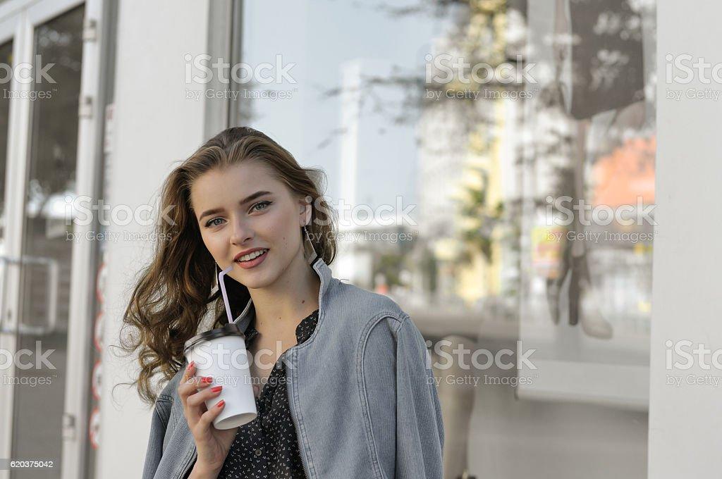 Pretty girl drinking beverage foto de stock royalty-free
