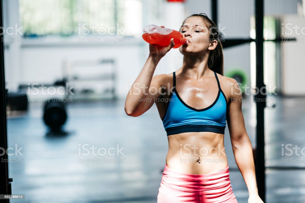 Pretty girl drinks flavored water stock photo
