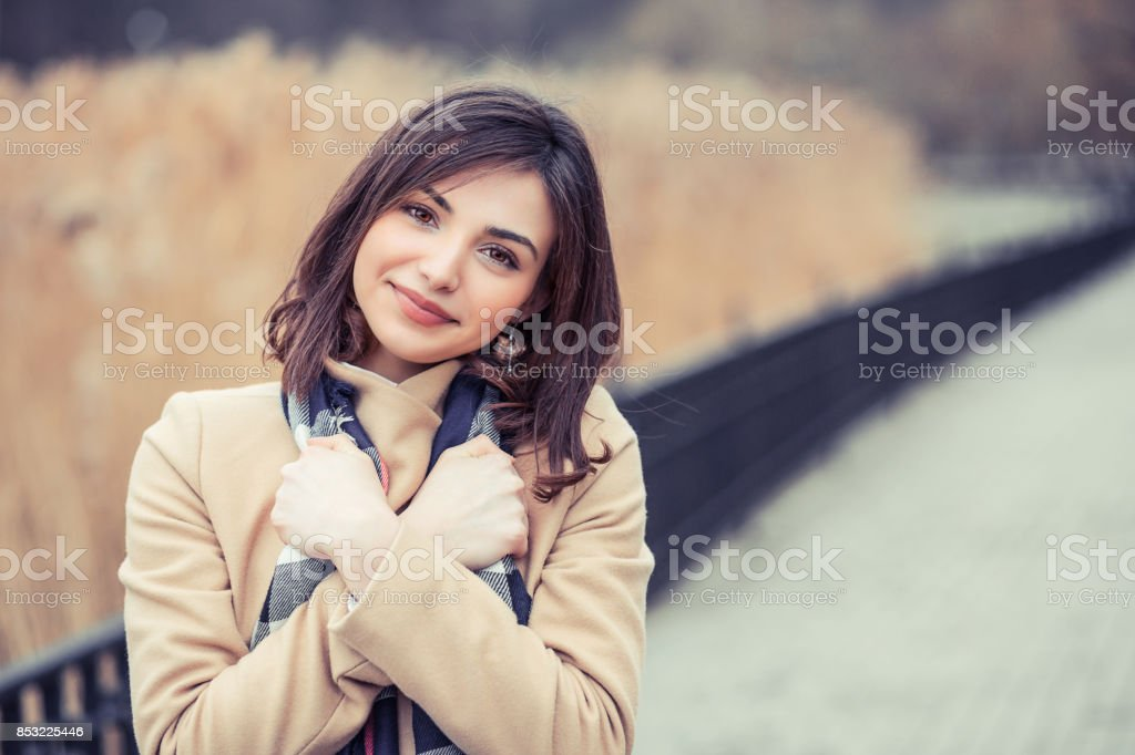 Pretty girl during a cold autumn day stock photo