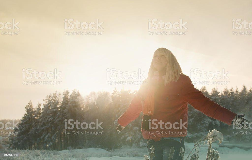 Pretty girl enjoys winter royalty-free stock photo