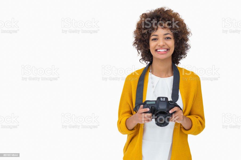 Jolie fille tenant un appareil photo - Photo