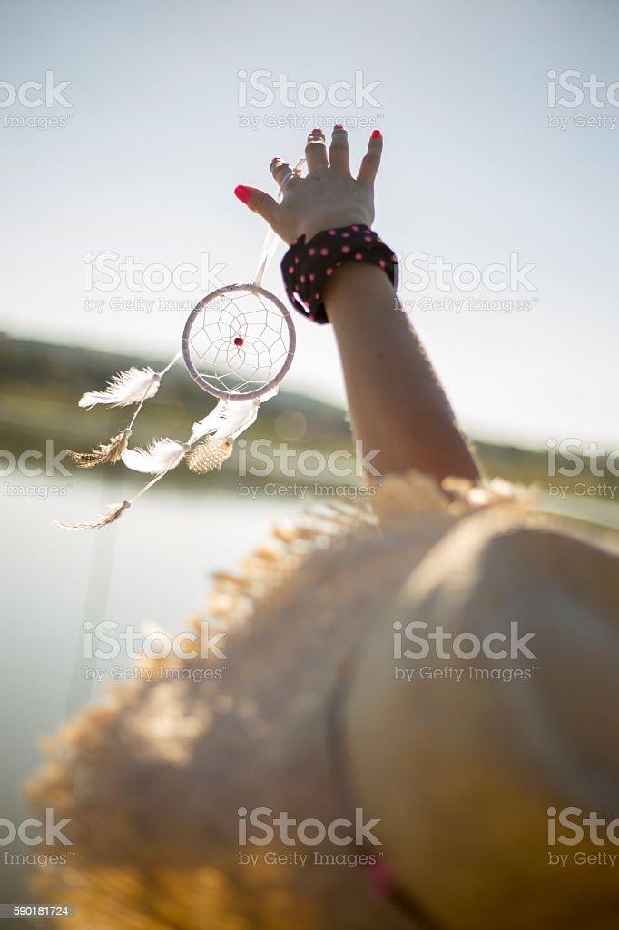 Pretty girl holding dream catcher in her hand - Photo