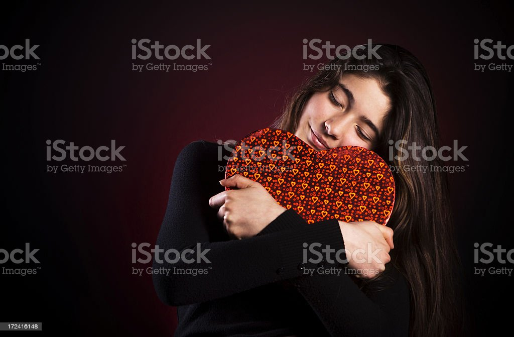Pretty girl holding red heart shaped box royalty-free stock photo