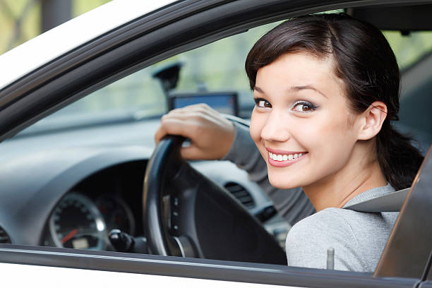 pretty girl in a car - driver stock photos and pictures