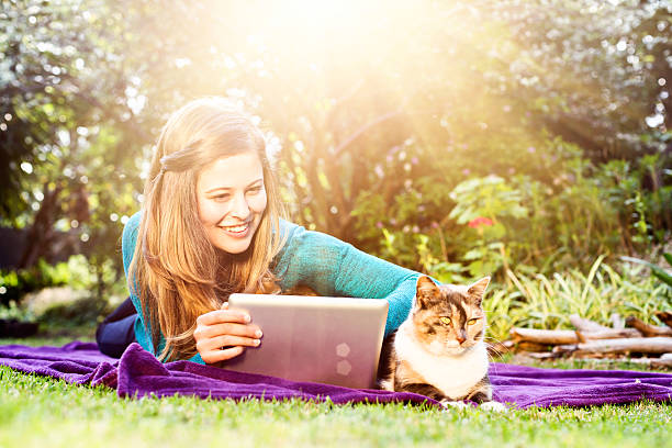 Pretty girl in garden with laptop and contented cat picture id487692684?b=1&k=6&m=487692684&s=612x612&w=0&h=i0de4a6wztc qcufqwfsexukwyyh ntxhffoy3vdrsw=