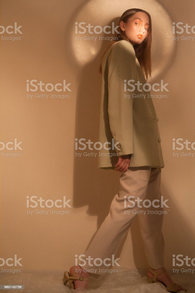 pretty girl in old fashion suit stock photo