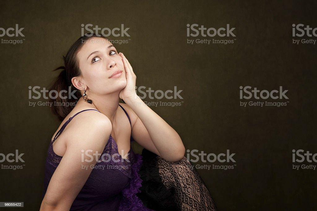 Pretty Girl in Purple on Green Background royalty-free stock photo