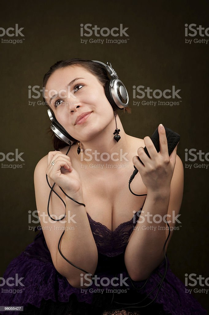 Pretty Girl in Purple on with personal audio device royalty-free stock photo
