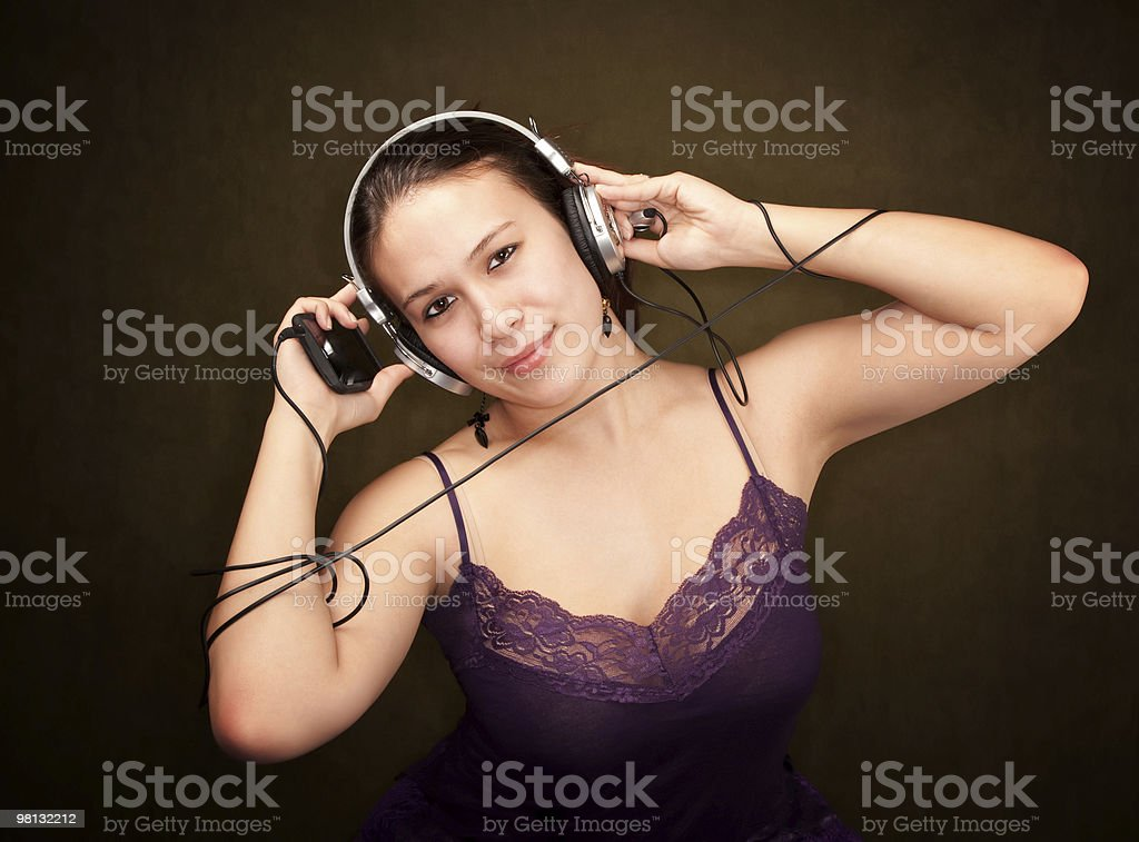 Pretty Girl in Purple with personal audio device royalty-free stock photo
