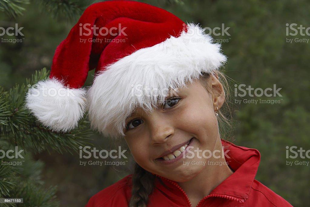 Niña bonita con sombrero de Santa foto de stock libre de derechos