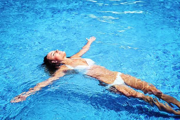 Pretty girl in swimming pool stock photo