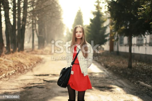 istock Pretty girl is walking in the city 179000692