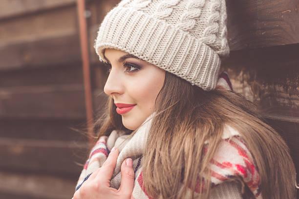 pretty girl is wearing warm winter clothes - wintermantel damen wolle stock-fotos und bilder