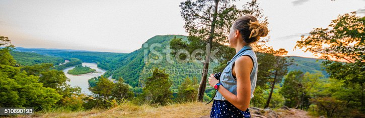 Pretty girl outlooking the scenic view at Delawar Water Gap. Pennsylvania, view to New Jersey's side