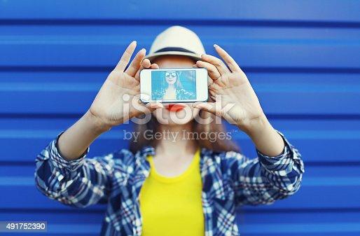 istock Pretty girl makes self-portrait on the smartphone 491752390