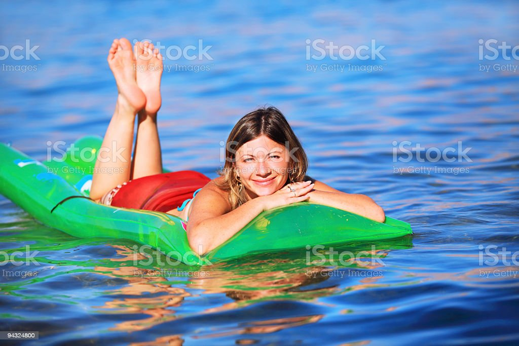 pretty girl on air mattress royalty-free stock photo