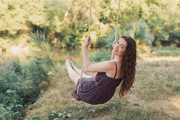 Pretty Girl On The Swing stock photo