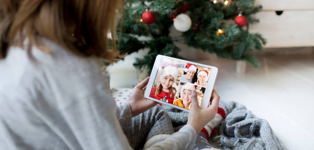 Pretty girl on video call with family during Christmas quarantine stock photo