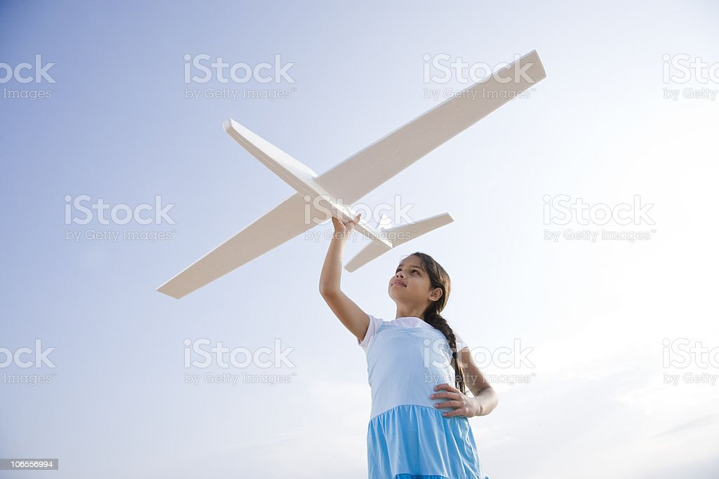 Pretty girl playing with toy glider stock photo