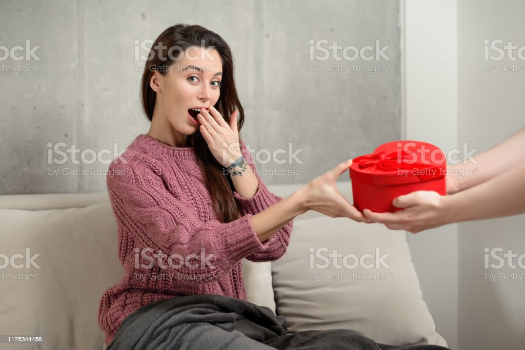 portrait of a happy excited young brunette girl receiving a...