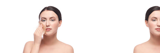 Pretty girl remove gloss. Face skin care. Matting napkins Pretty girl remove gloss. Face skin care. Matting napkins. Demakeup cosmetics tissue. Self home routine. Young woman dermatology procedure. White background. Isolated. Horizontal banner with copyspace blotting paper stock pictures, royalty-free photos & images