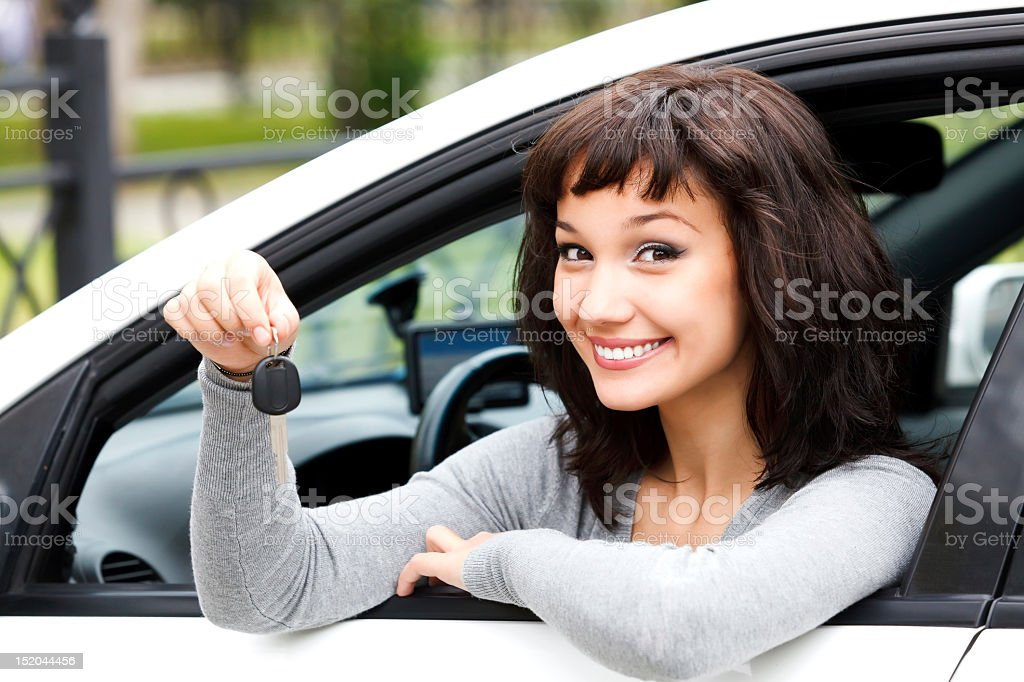 Pretty girl showing the car key stock photo