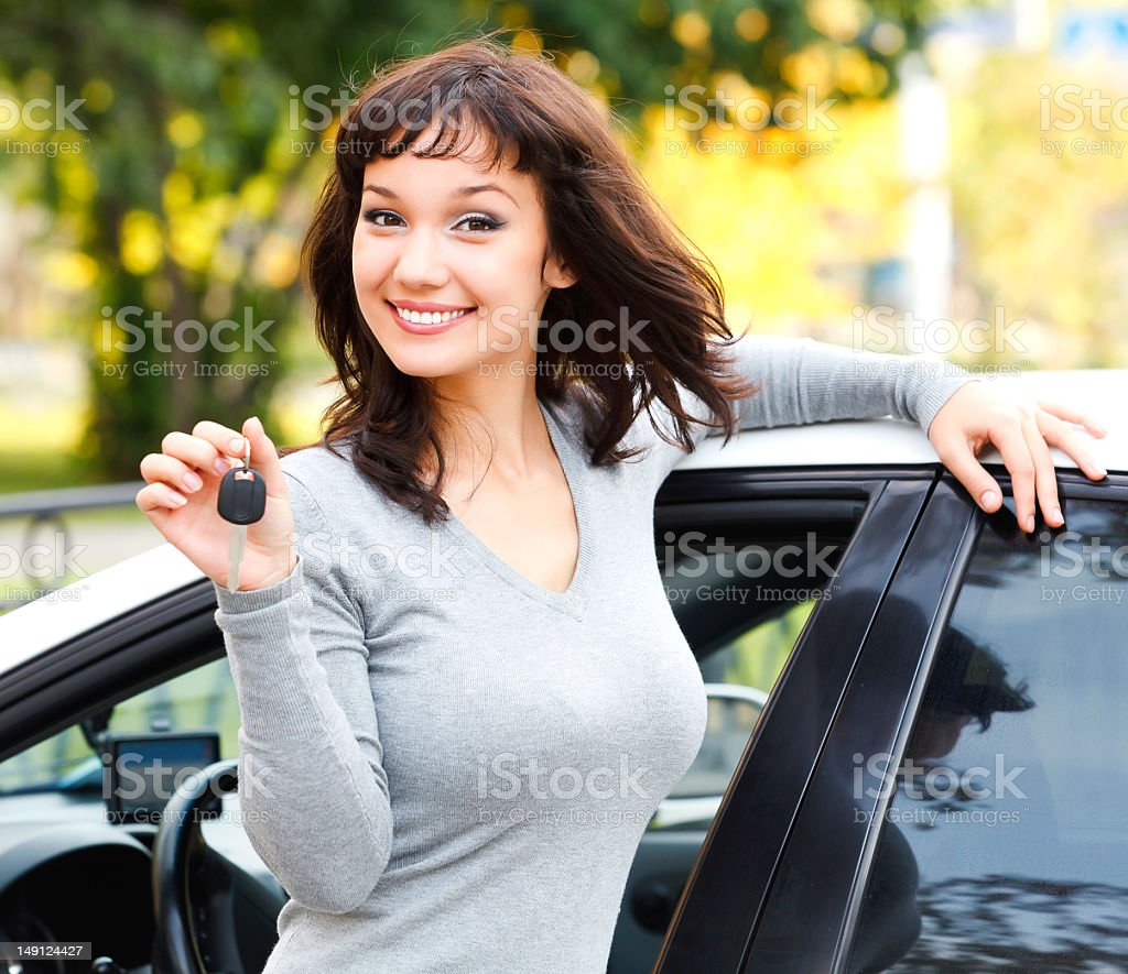 Pretty girl showing the car keys and smiling stock photo