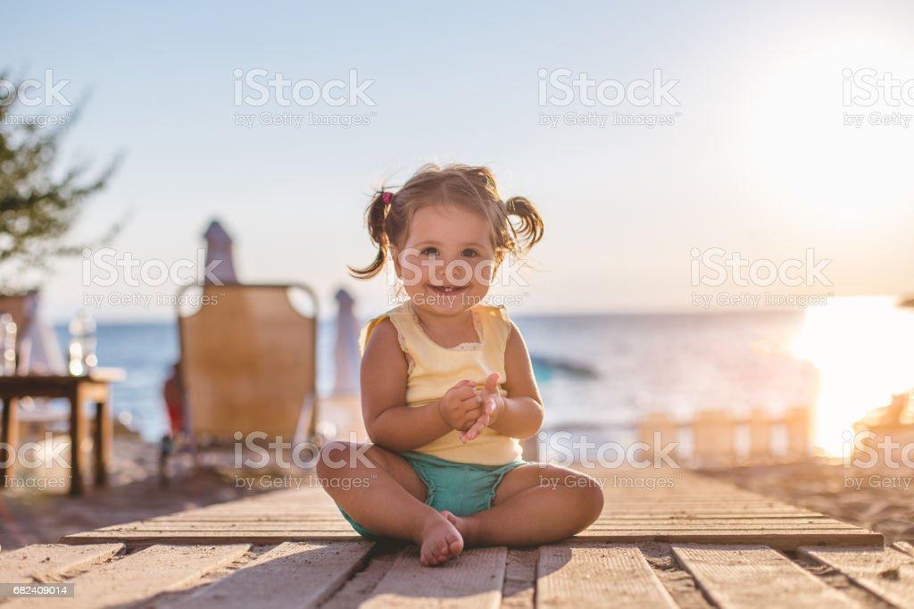 Pretty girl sitting in the sun stock photo
