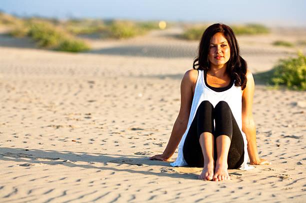 Pretty Girl Sitting on Beach stock photo