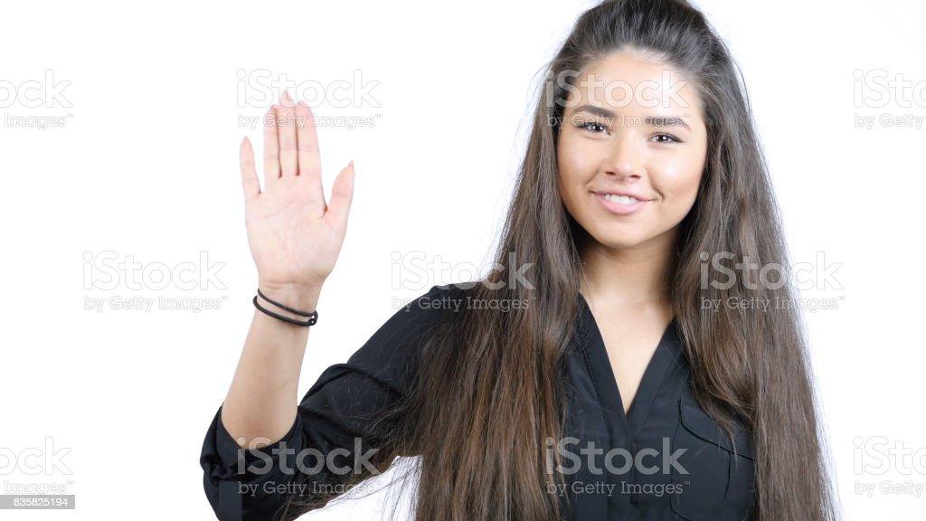 pretty girl waving hand, Hello stock photo