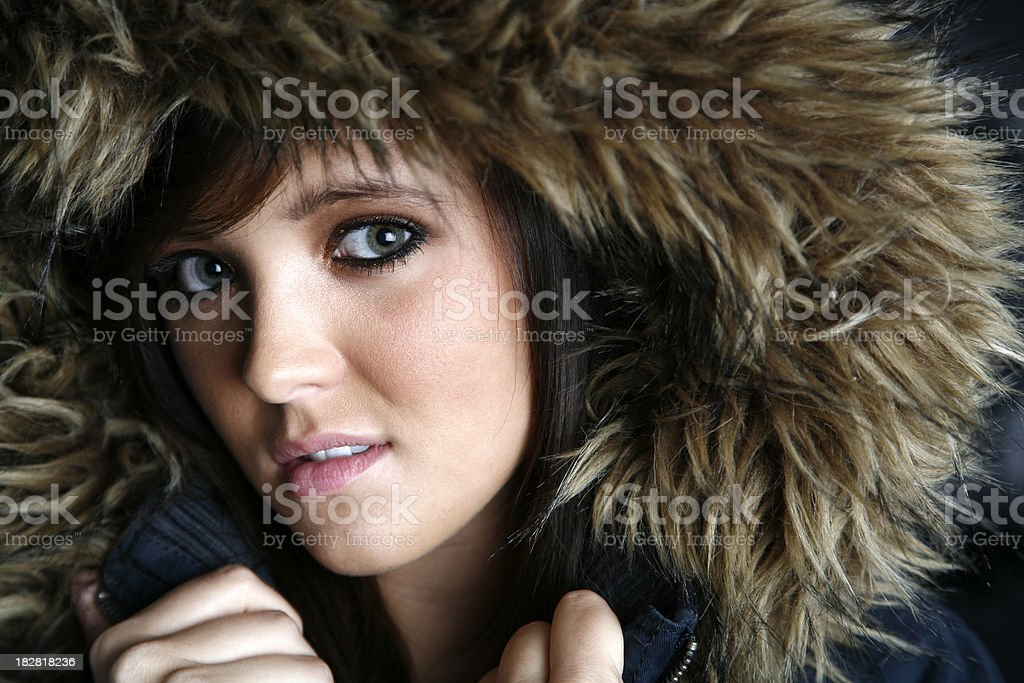 Pretty Girl With a Fur Hooded Coat stock photo