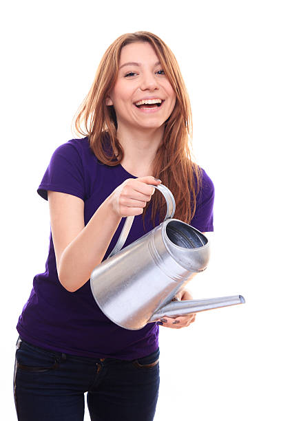 Pretty girl with a watering can