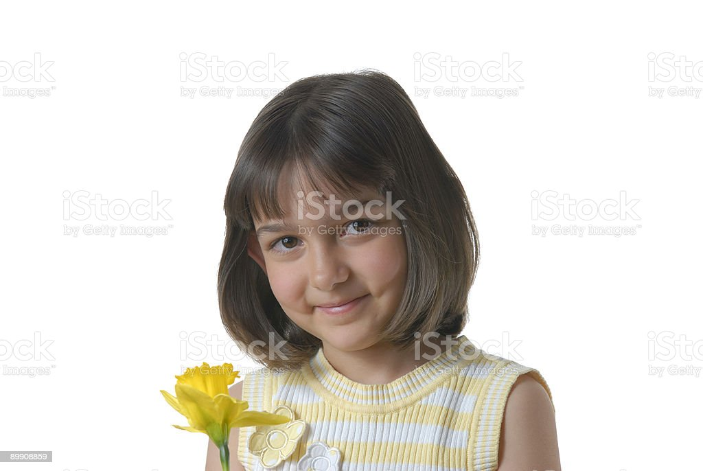 Pretty girl with a yellow flower royalty-free stock photo