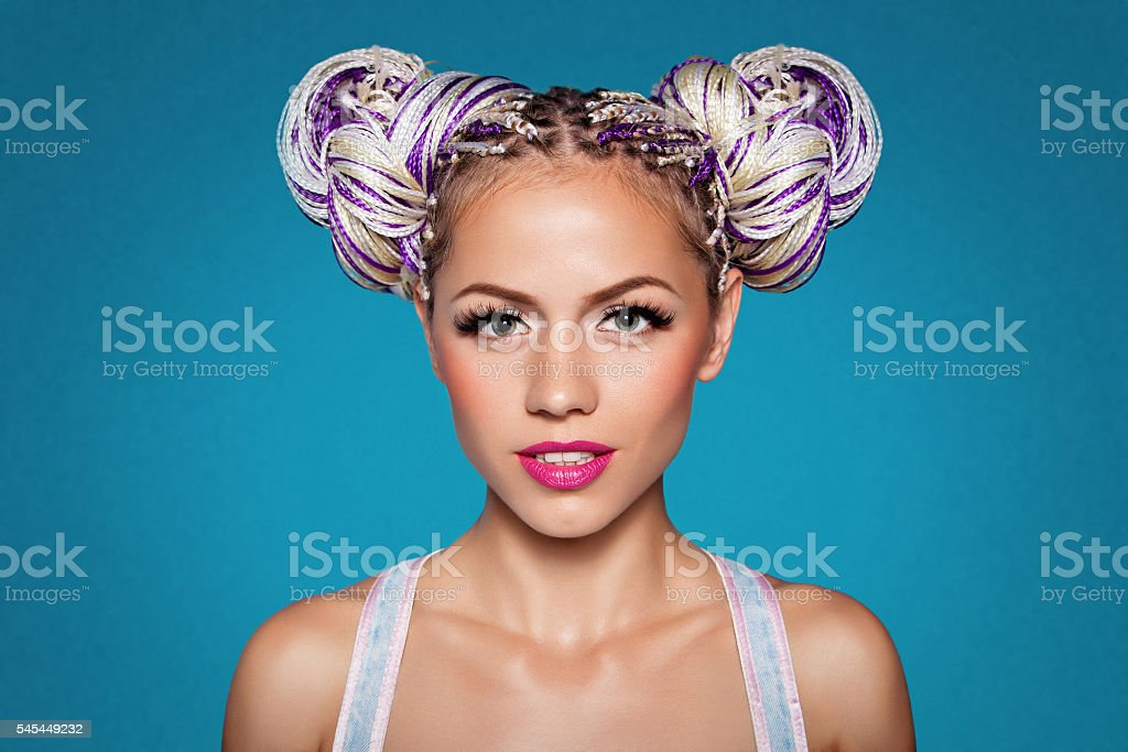 pretty girl with african braids and two hair bun stock photo