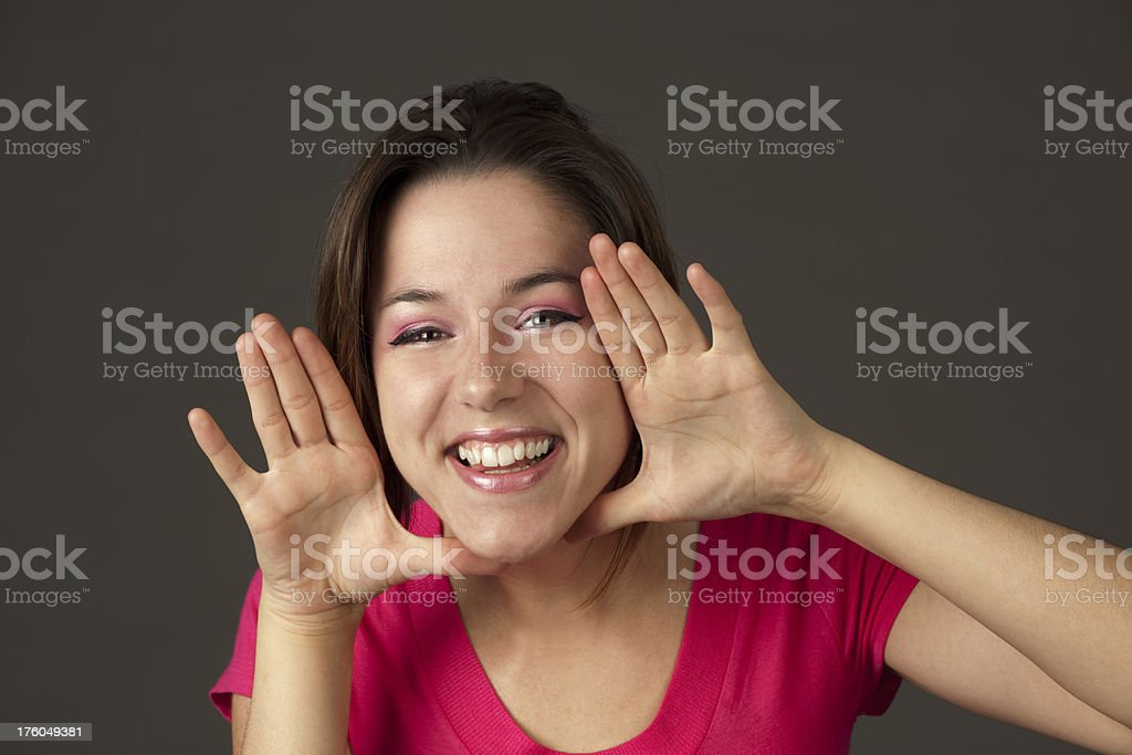 \'Girl with amazing smile framing face with hands. This is a...
