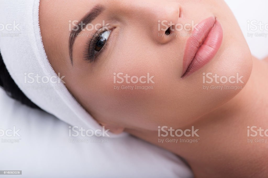 Pretty girl with artificial lashes at salon stock photo