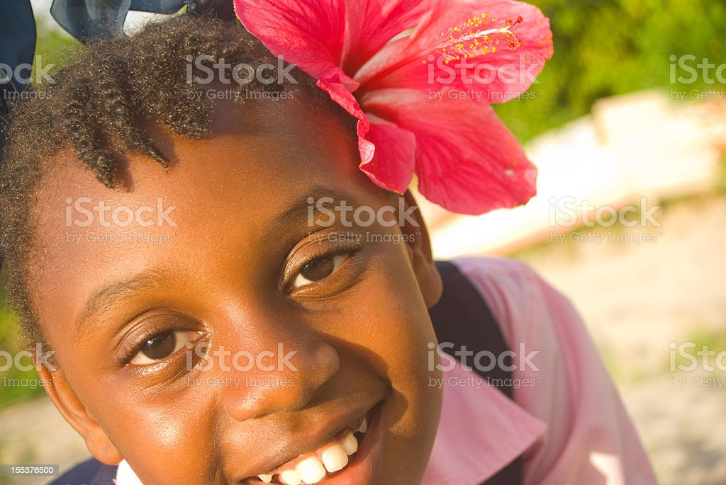 pretty girl with flower in hair smiling stock photo