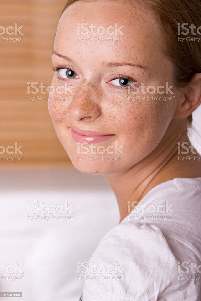 Pretty girl with freckles royalty-free stock photo