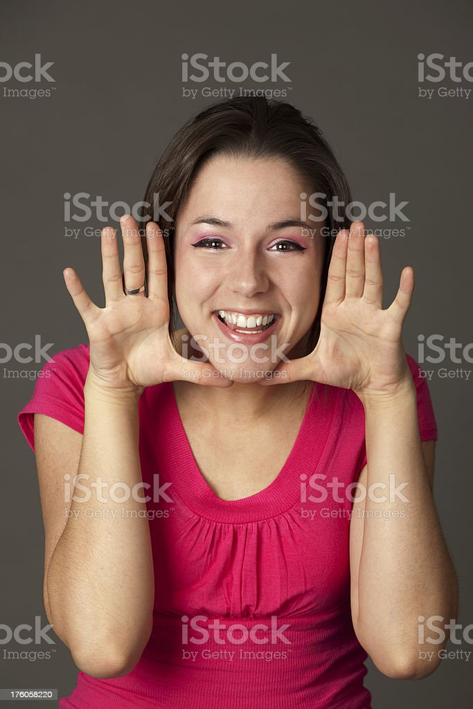 Pretty Girl With Great Big Fun Smile ,Hands Framing Face royalty-free stock photo