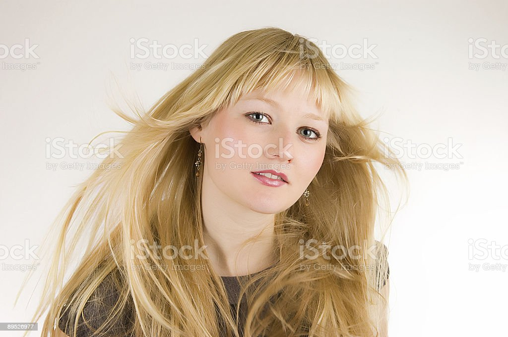 Pretty girl with her hair weaving in the wind royalty-free stock photo